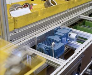 Reliable conveyor systems for order picking on an assembly line with compact angular geared motors.