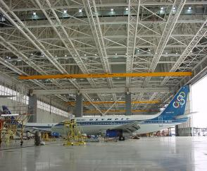 Suspension crane attached to five runway rails in a hangar
