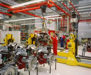 Crane installation with internal conductors and DC-Pro chain hoist in an engine production line