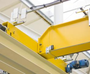 EKKE single-girder overhead travelling crane: end carriages ready for connection to the crane girder