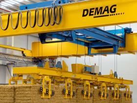 automated travelling crane for biomass logistics